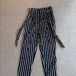 striped gold and black tie pants